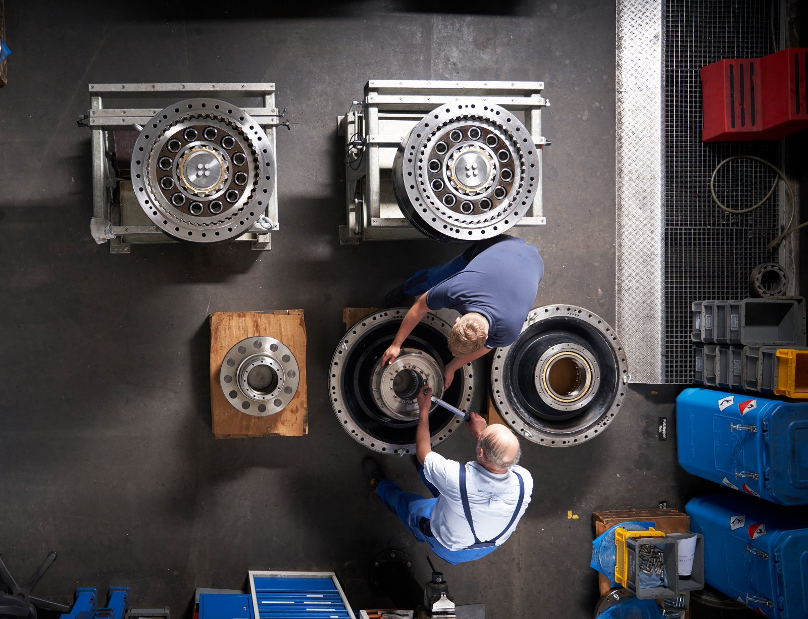 Bird's eye view of technicians and gearboxes